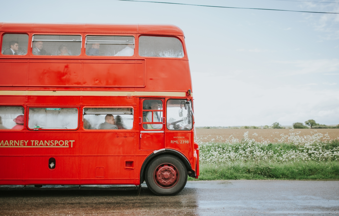 Red double-decker bus transports wedding guest