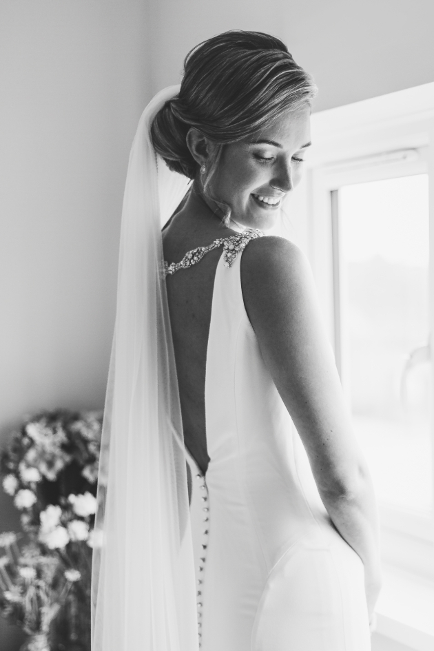 Bride wearing the Janine dress from Blue by Enzoani