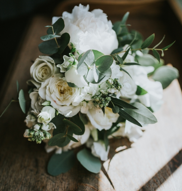 Flower arrangement using a palette of greens and ivory