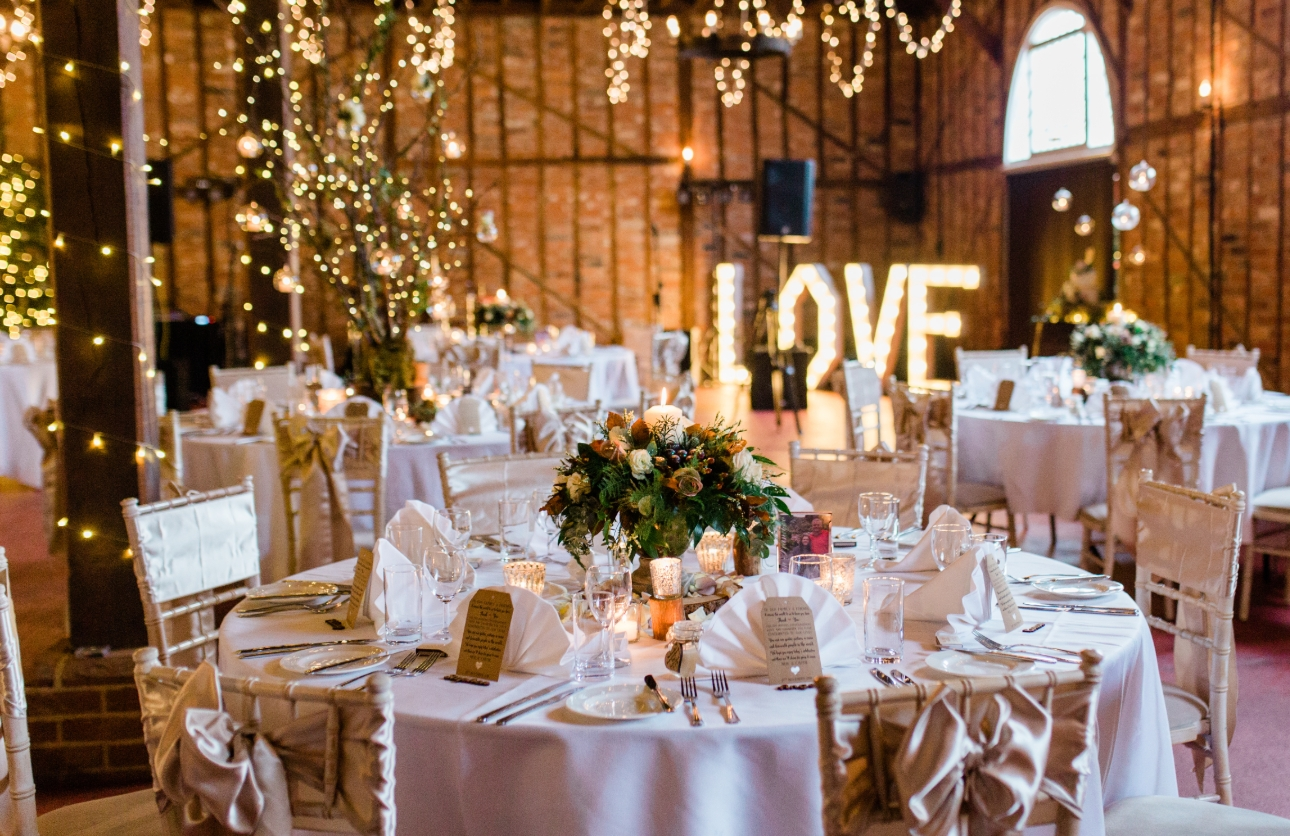 Coach House at Marks Hall Estate dressed with fairy lights and large LED letters spelling love
