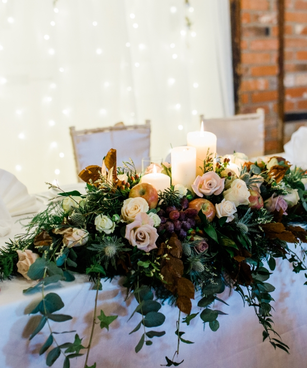Top table dressed with flowers and candles