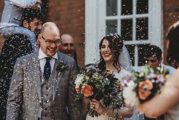 Couple showered with confetti