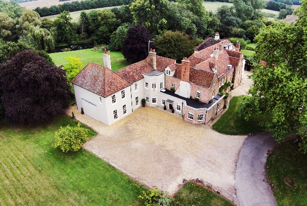 historic venue with cream facade and red slate roof with ample grounds